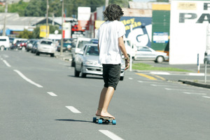 This skate boarder was taking his life in his own hands travelling down Hannah Street. Photo / Ron Burgin
