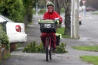 Postman on his round in Totara Street, Masterton. Photo / APN