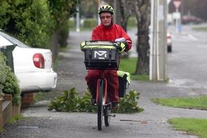 Postman on his round in Totara Street, Masterton. Photo / APN