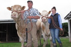 Southern Hawke's Bay charolais studmaster Simon Collin with seven-year-old bull Rauriki Beaujolais at the Hawke's Bay Show, with steer Gaylord and daughter Lucy.