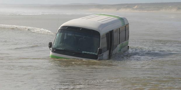 The submerged bus on Ninety Mile Beach. Photo / Peter Jackson