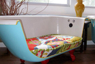 An old bathtub has been given a new role - as a couch.