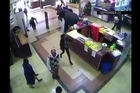 Newly released security video shows gunmen indiscriminately opening fire on shoppers at the Westgate shopping mall in Nairobi during a siege which left at least 67 people dead. Warning: video contains graphic violence.