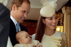The Duke and Duchess of Cambridge with Prince George before the christening ceremony at St James' Palace. Photo / AP