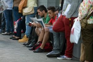 People wait outside an unemployment registry office in Madrid, Spain. Photo / AP