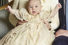 Prince George seems pretty happy at his christening.Photo / Jason Bell
