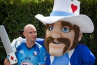 Auckland captain Gareth Hopkins lays his cards out with the Aces' new mascot. Photo / Greg Bowker