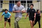 NRL star Willie Mason found time on a visit to Whangarei to have a game of touch with students at Te Kura O Otangarei. Chasing hard to tag Willie Mason are Xavier Paoro (left), Jaedan Godsell and Francis Poutai. Photo / John Stone