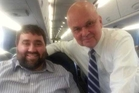 Blogger Tom Matzzie (left) plucked up the courage to ask Michael Hayden for a photo after the train indiscretions.