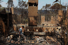Noel Willis inspects his home destroyed by fire in Winmalee, Australia. Photo / Getty Images