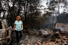 Leanne Brown inspects the remains of her home following severe bush fires. Photo / Getty Images