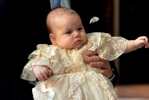 3-month-old Prince George appears at his christening, held by his father. Photo / AFP