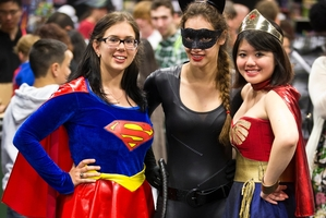 Super heroes, from left, Sabina Giurgiu, Sian Camp and Adelie Tan rub shoulders with fellow fans at the Armageddon Expo. Photo / Greg Bowker