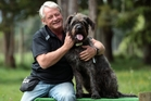 Animal trainer Mark Vette with his star dog Monty at his property in Waimauku, Auckland. Photo / Doug Sherring