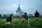 TJ Perenara of the All Blacks passes during a New Zealand All Blacks training session at the Yoyogi Gymnasium. Photo / Getty Images