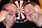 ON TARGET: Rotorua Dart Club members Paul Easton (left) and Sean Strickett are keen to grow a mo for Movember. PHOTO/BEN FRASER 311013BF31