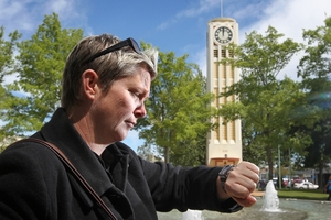 KEEPING IN TIME: Andrea Taaffe, city centre events and promotions manager, checks her watch at 1.10pm when the Hastings Clocktower shows noon, or midnight. PHOTO/DUNCAN BROWN HBT133496-01