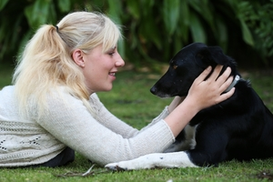 TOGETHER AGAIN: Kate Purchase with her dog Ash, who went missing after it fell out of a ute.PHOTO/JOEL FORD