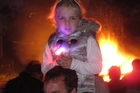 TOP ANGLE: Five-year-old Jana Vujcich from Pakaraka takes in the view from dad Vaughan Vujcich's shoulders during last year's fireworks show. PHOTO/PETER DE GRAAF
