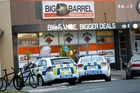 Police investigate a theft and assault by an unknown trio at Big Barrel in Clive. Photo / Glenn Taylor