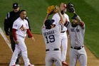 Boston Red Sox relief pitcher Koji Uehara celebrates with Mike Napoli as they tie the series. Photo / AP