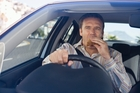 Driving a car and eating can be hazardous. Photo / Getty Images