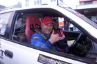 IN THE HOT SEAT: Roger Brader as his many friends remember him, giving the thumbs up behind the wheel of his Racetech Rally Wairarapa car, in 2004. PHOTO/FILE