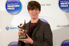 British musician James Blake smiles after winning the Mercury Prize 2013 award in London. Photo / AP