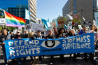Demonstrators march outside of the U.S. Capitol in Washington during a rally to demand that the U.S. Congress investigate the NSA's mass surveillance programs. Photo / AP