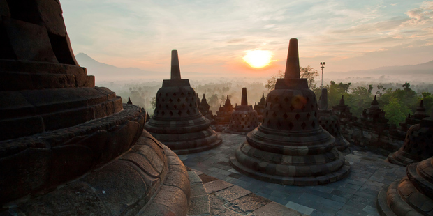 The 1100-year-old Borobudur Temple pops up like a volcano from mist-shrouded jungle. Photo / Getty Images