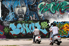 Tourists take a Vespa tour through Miami's Design District in search of the city's best graffiti art. Photo / AP