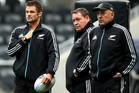 Richie McCaw stands with All Black management Steve Hansen and Gilbert Enoka. Photo / Getty Images