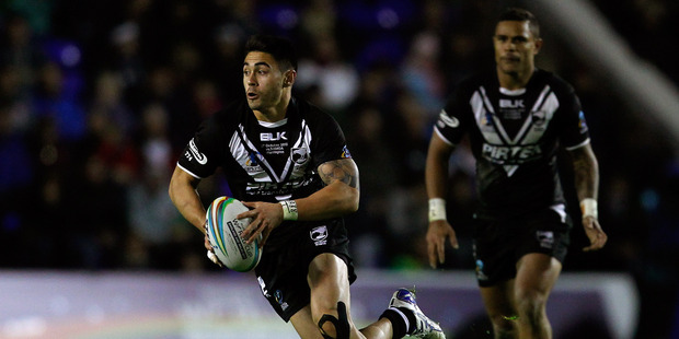 Shaun Johnson (L) of New Zealand in action during the Rugby League World Cup Group B match between New Zealand and Samoa at the Halliwell Jones Stadium on October 27. Photo / Paul Thomas.