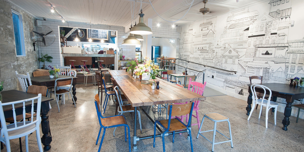 Little King Cafe has an impressive array of tables and chairs, mixing an industrial look with vintage timber.
