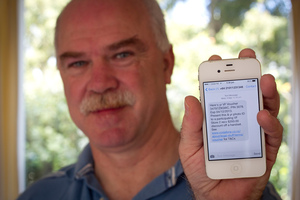 Nick Winspear was sent a voucher from Vodafone to upgrade his phone but has been told he can't use it toward a new iPhone. Photo / Natalie Slade