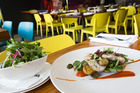 Grilled Game Fish (King Fish) with Green Olive, Capsicum Gel, Wild Rocket, Sweet Onion and Garlic Baby Potato. Photo / NZH