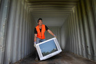 Shaun Barnes, 23, has volunteered his time to Envirohub to help recycle old televisions. Photo / John Borren