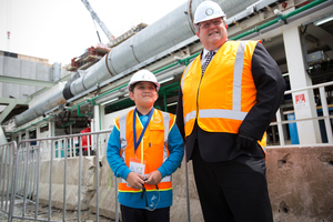 Branden Hall, 10, with Transport Minister Gerry Brownlee after Branden started 'Alice' the tunnel drilling machine which was fired up for the start of Waterview Tunnel project. Photo / Greg Bowker