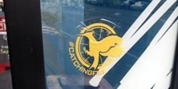 There are over 50 of these yellow Catching Fire logos on one side of Jervois Rd.