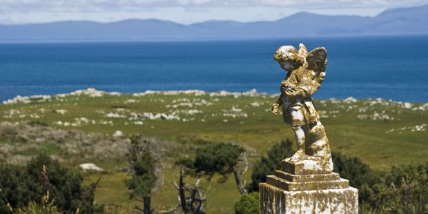 The Old Bluff Cemetery is in a striking location, straddling a hill that overlooks Bluff Harbour and town on one side and Foveaux Strait and Stewart Island on the other. Photo / Chris Samsara