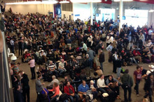 Crowds wait in Los Angeles International Airport. Photo / AP