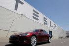 A Tesla Model S driving outside the Tesla factory in Fremont. Photo / AP