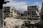 Buildings are seen damaged from the shelling of Syrian forces at Karm al-Jabal area in Aleppo province, Syria. Photo / AP