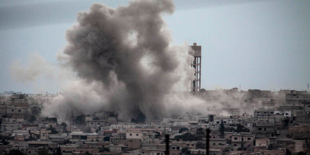 Smoke rises from buildings from an airstrike that hit Habit village, in the Syrian central province of Hama on Sept 22. Photo / AP