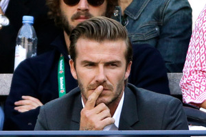 David Beckham watches play between Rafael Nadal, of Spain, and Novak Djokovic, of Serbia, during the men's singles final of the 2013 U.S. Open tennis tournament, Monday, Sept. 9, 2013, in New York. (A
