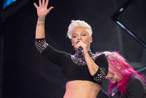Pink has hit back at those who think she shouldn't let her daughter ride on a motorcycle. Photo / AP