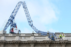 Engineers look at the damage as a crane working on redevelopment at the Cabinet Office in Whitehall, near to Downing Street in London, was brought down by high winds. Photo / AP
