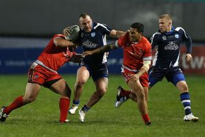 Scotland's Kane Linnett, centre, and Ben Fisher, right, with Tonga's Willie Manu, 2nd right, and Fuifui Moimoitheir in action during their 2013 Rugby League World Cup match. Photo / AP.