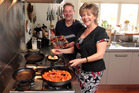 Grant Allen and Julie Biuso cook up a storm. Photo / Doug Sherring
