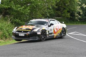 Five-time Targa winner Tony Quinn and co-driver Naomi Tillett in action. Picture / Groundsky Photography